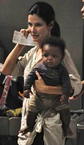 Sandra-Bullock-Baby-Louis-Playground-12122011-6-675x900