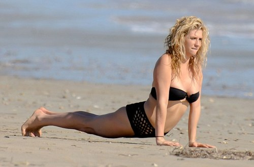 **EXCLUSIVE** Ke$ha flashes some flesha in a granny-panted string bikini!